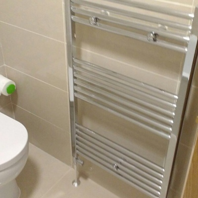 Towel radiator and tiling